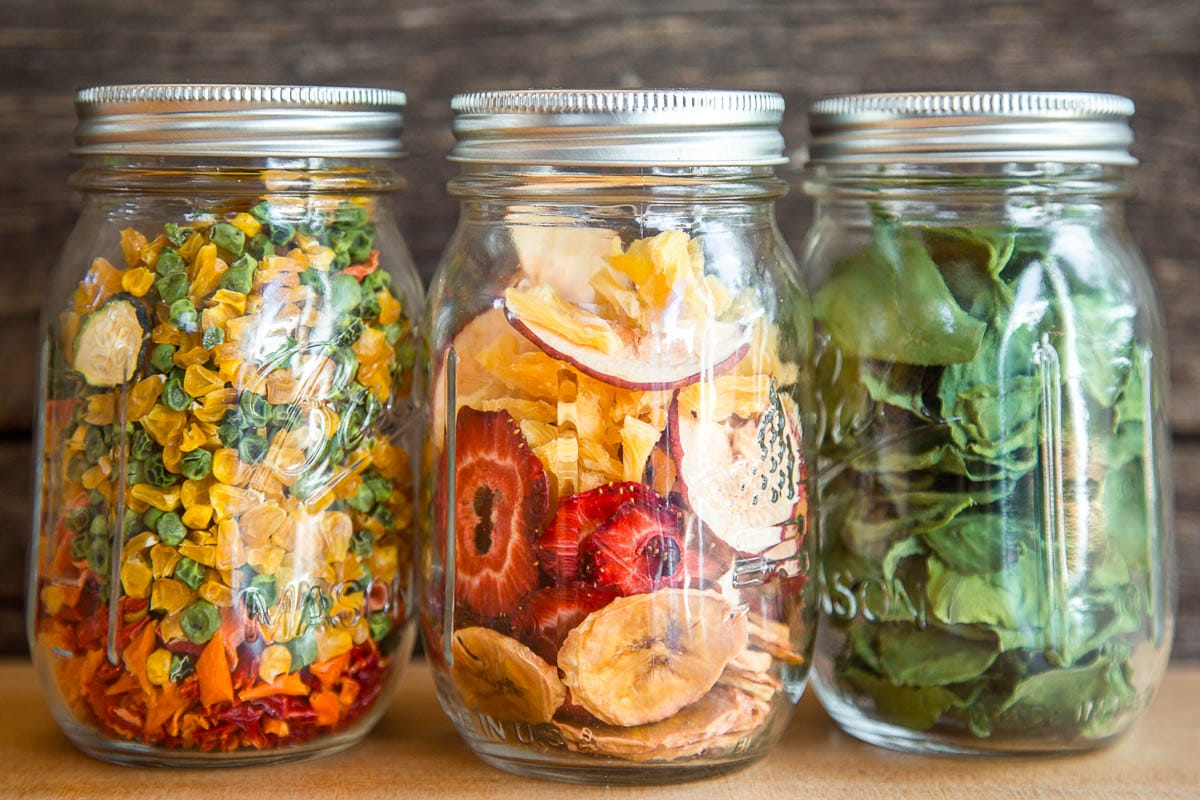 Dehydrated fruit and vegetables in three canning jars