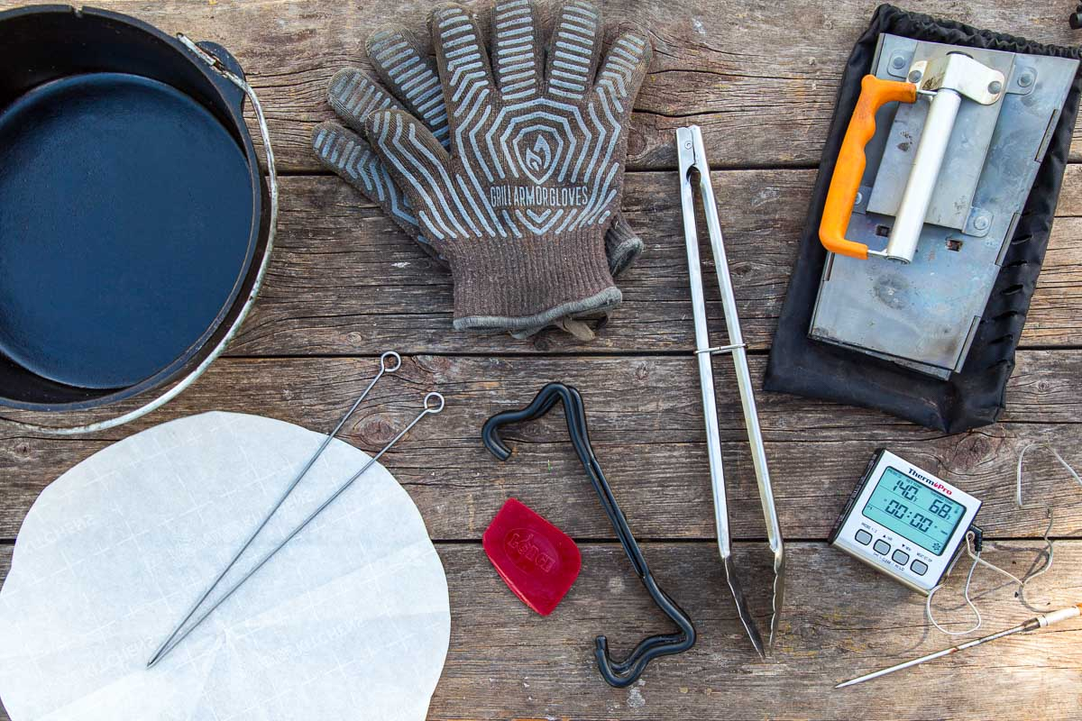 Dutch oven accessories laid out on a wooden surface