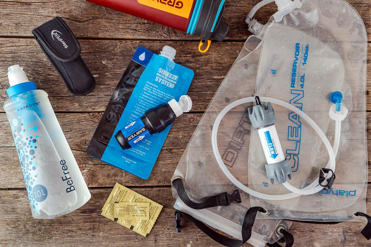 An overhead view of a variety of backpacking water filter options