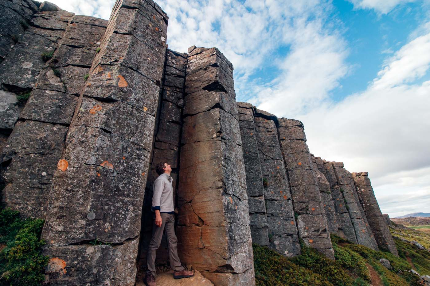 Man standing among the basalt columns of the Gerduberg Cliffs on Iceland's Snaefellsnes Peninsula