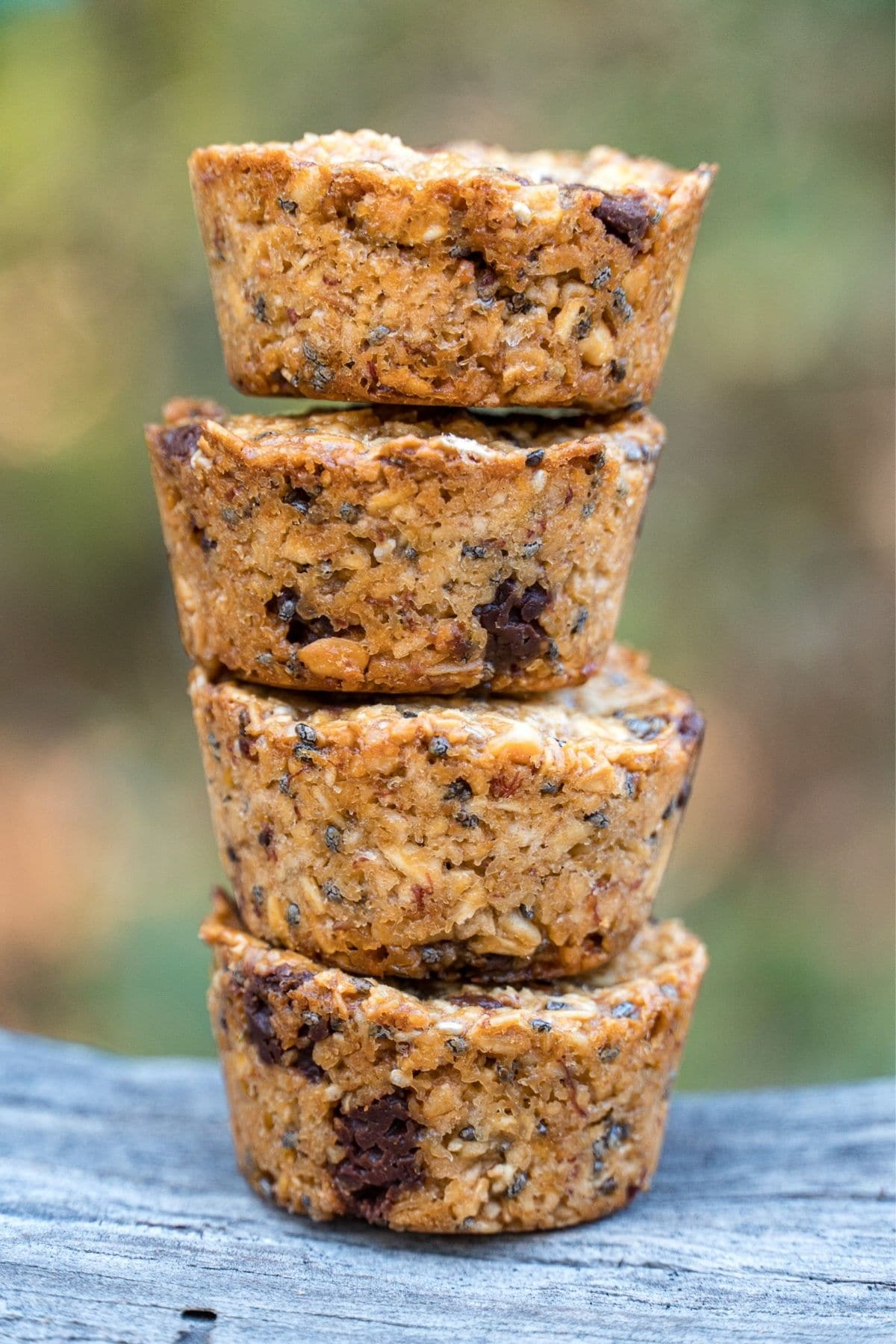 Four granola bites stacked with a natural background