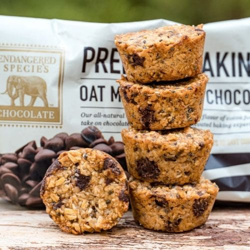 Granola bites stacked next to a package of Endangered Species Chocolate Chips