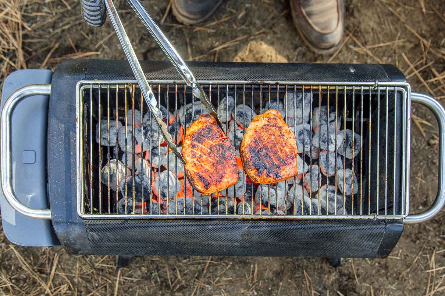 Grilling pork loin on a camping grill