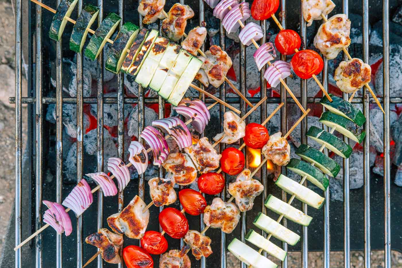 Skewered vegetables and chicken on a grill