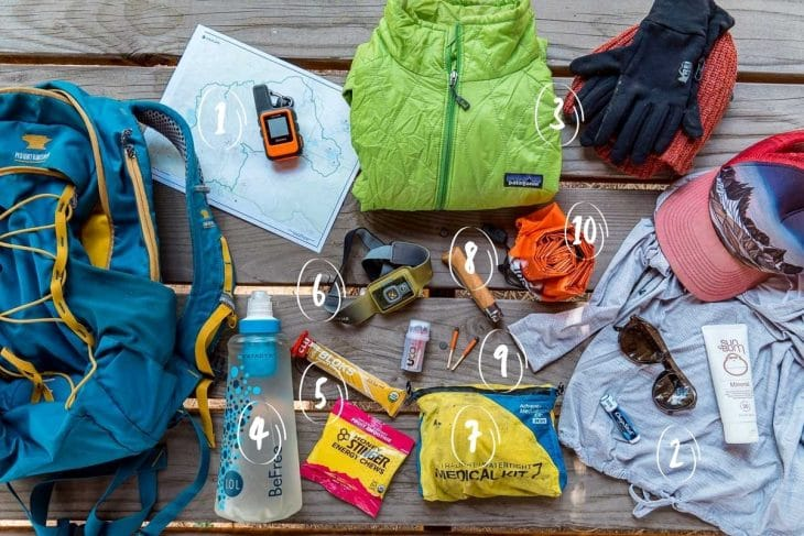 Flatlay of all the hiking 10 essentials with numbers