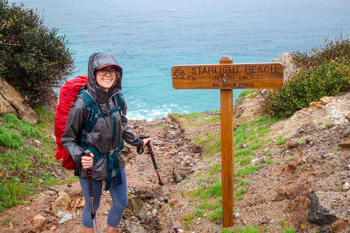 Megan wearing rain gear during a rainy hike