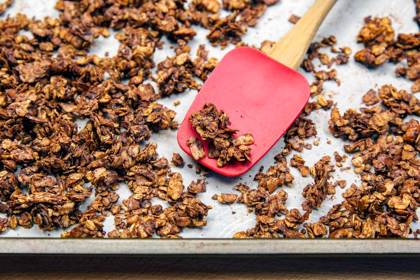 Coconut chocolate granola on a baking sheet