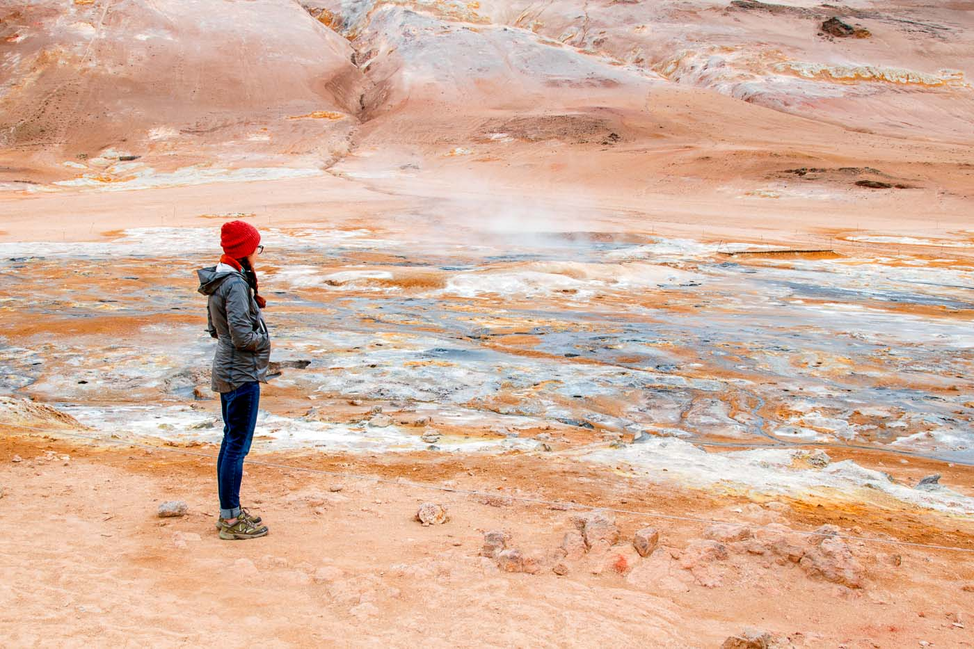 Woman standing in front of the Hverir geothermal field