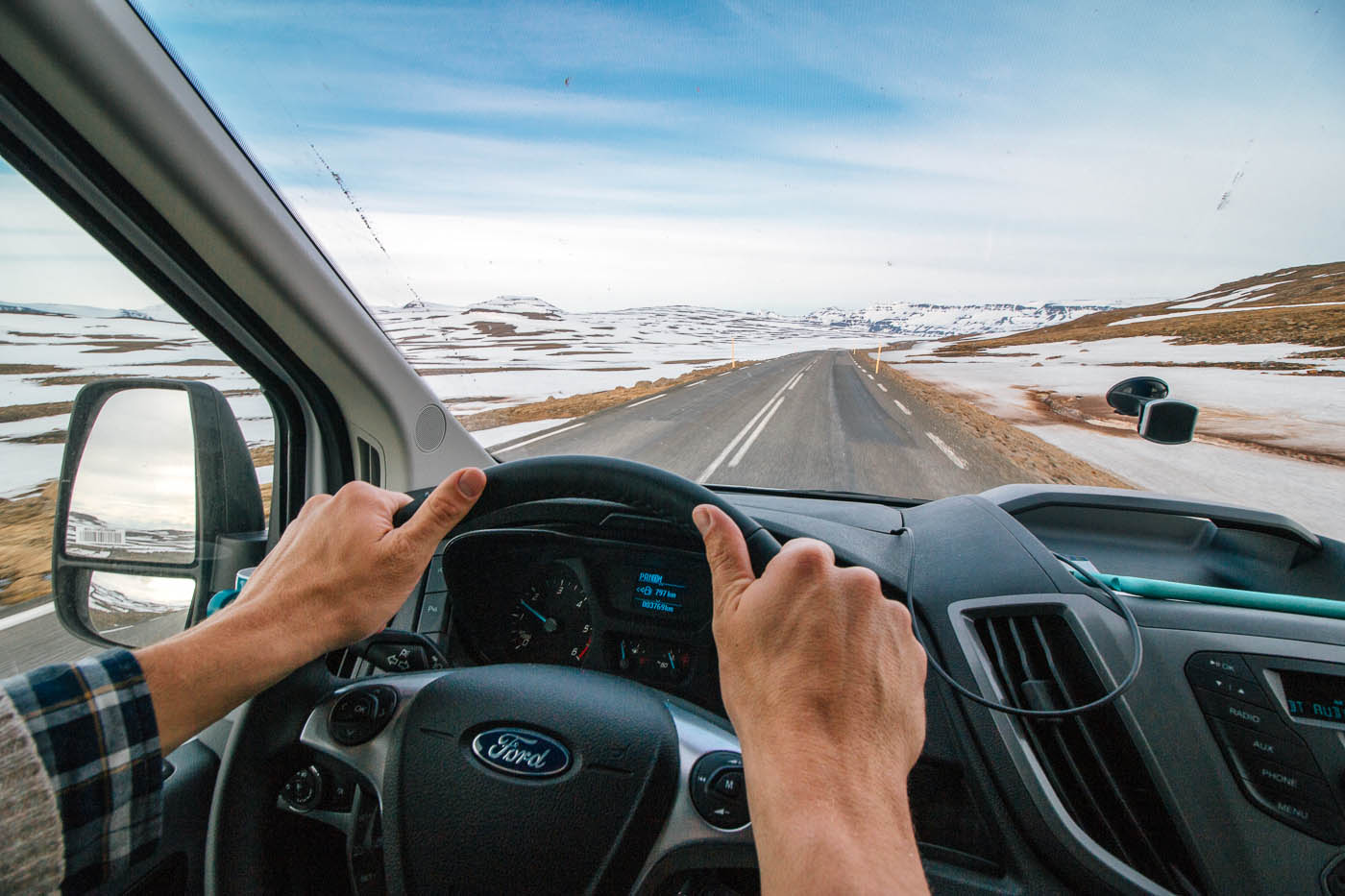 POV shot of driving a campervan on a road in Iceland