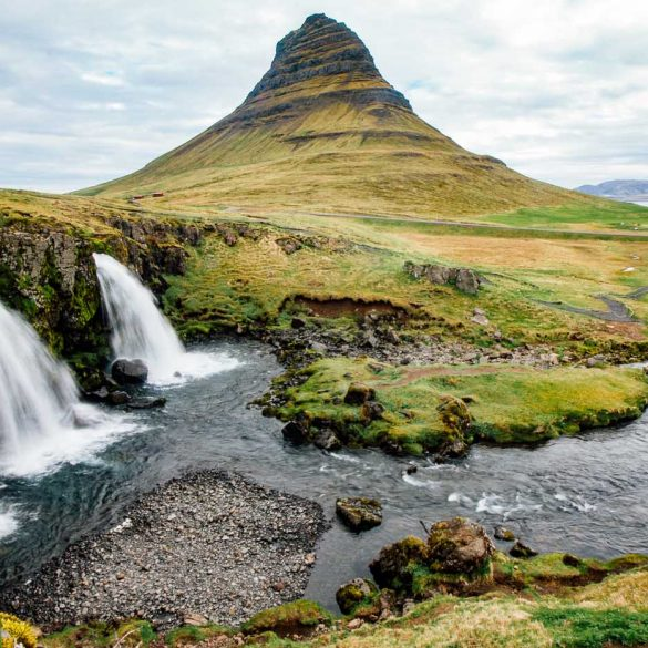 The Kirkjufellsfoss waterfall with the Kirkjufell mountain in the distance