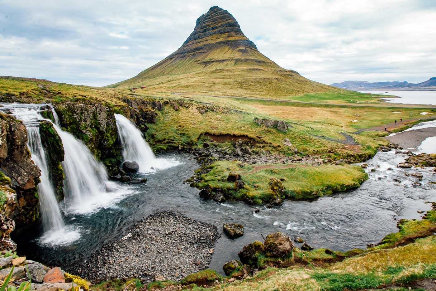 The three Kirkjufellsfoss waterfalls with the Kirkjufell mountain in the background