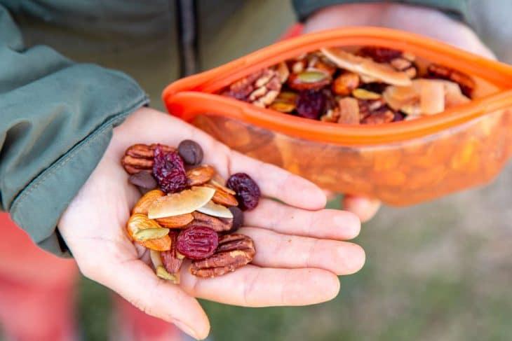 Megan holding a handful of homemade granola