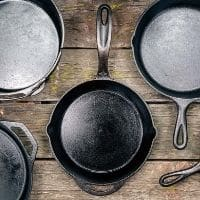 Cast iron skillets on a wood table
