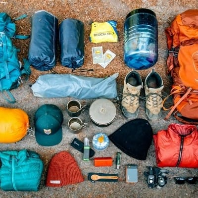 Camping gear laid out on the ground
