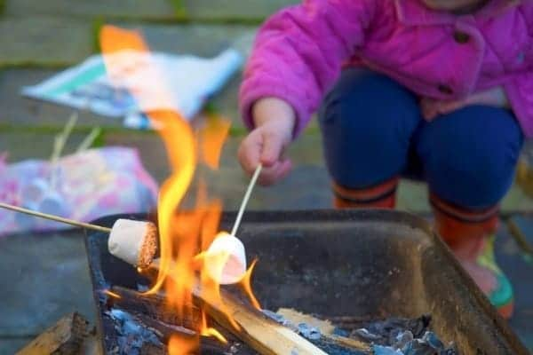 Child roasting a marshmallow
