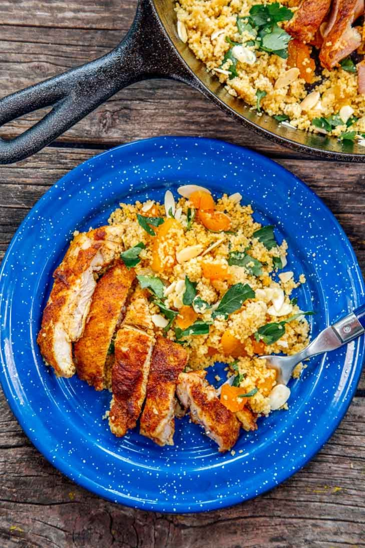 Moroccan spiced chicken on a blue camping plate