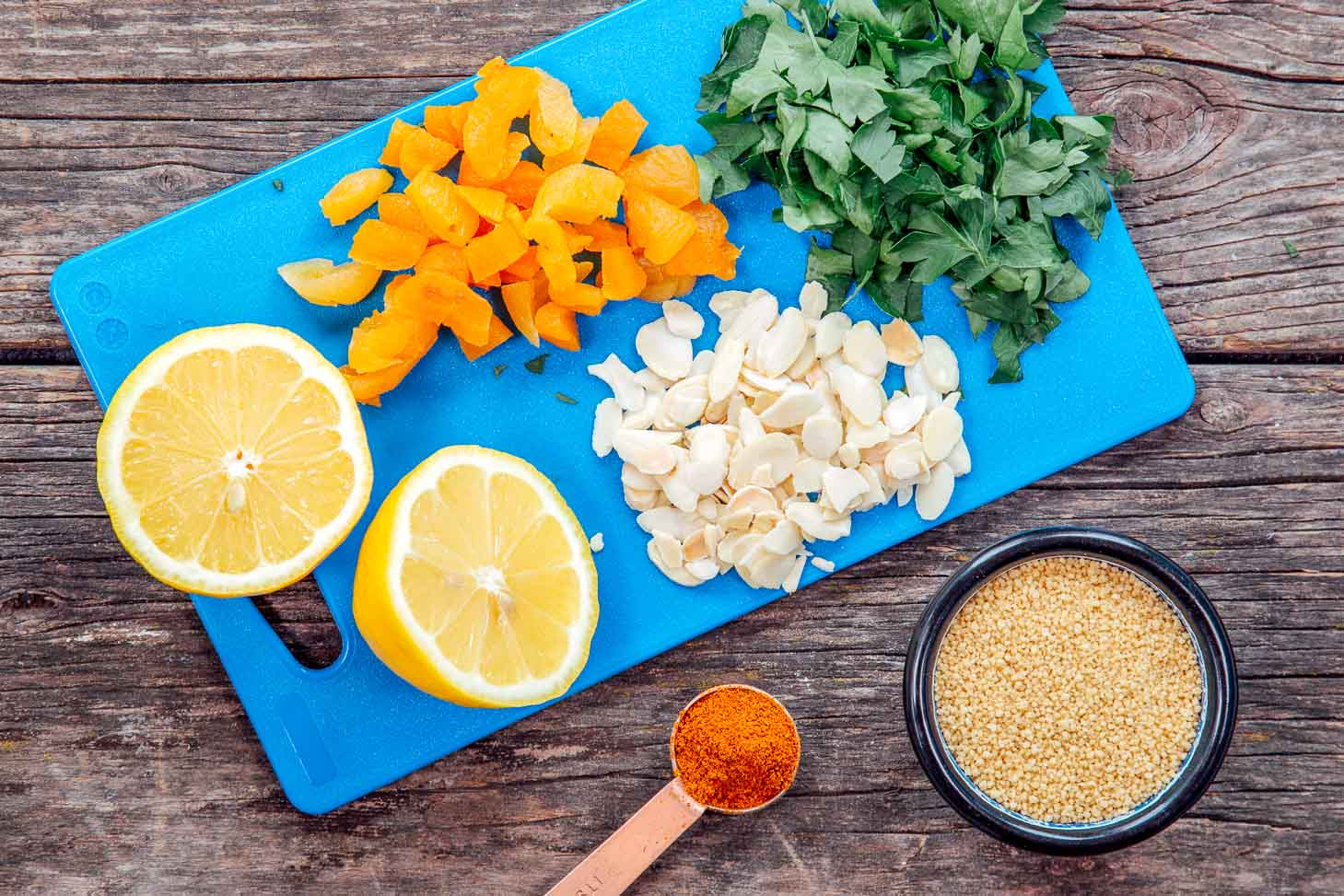 Ingredients for Moroccan spiced couscous on a cutting board