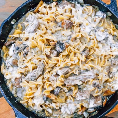 Beef stroganoff with noodles in a cast iron skillet
