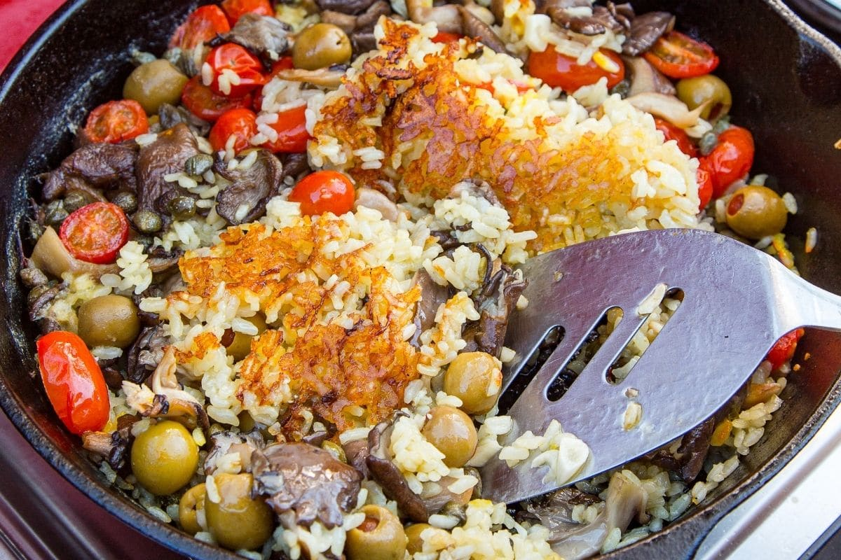 A close up of paella socarrat (crispy rice) in a skillet