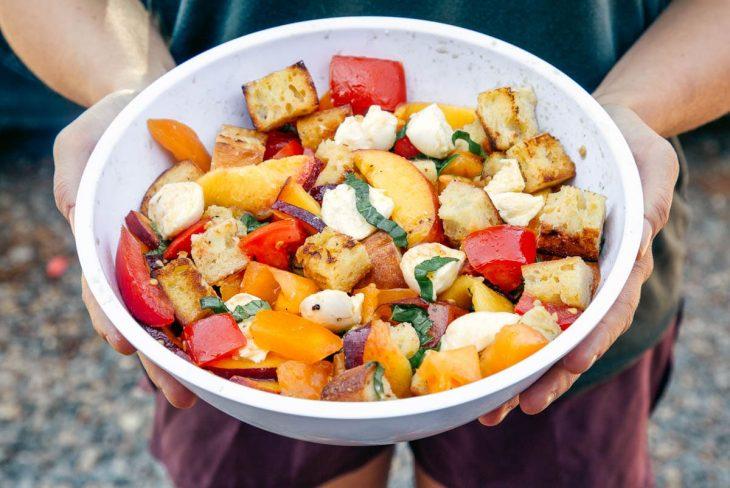Megan holding a bowl of panzanella bread salad