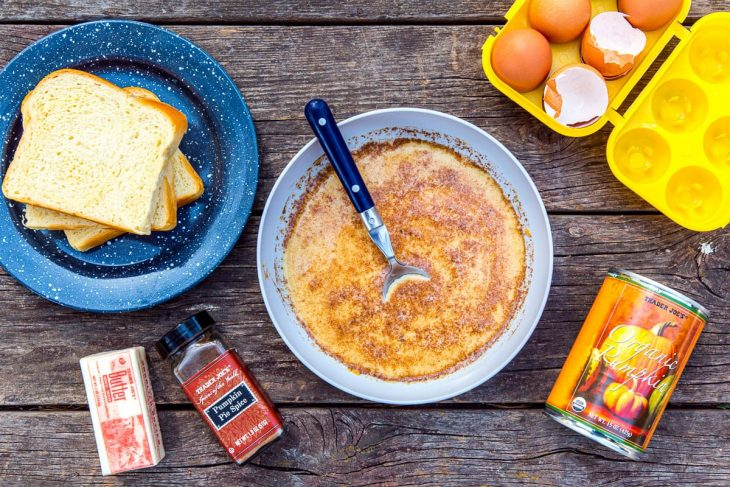 Pumpkin French toast batter in a bowl with other ingredients around it