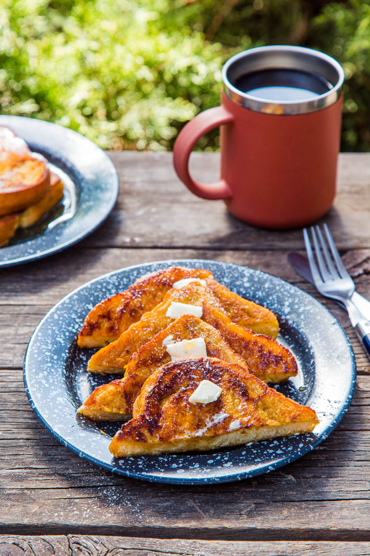 Four slices of pumpkin French toast on a blue plate
