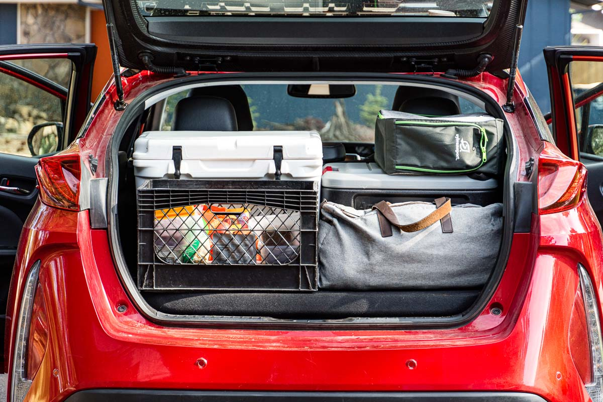 The trunk of a car organized with road trip essentials