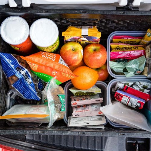 A box full of road trip snacks