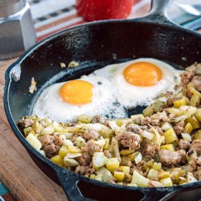 Sausage and fennel hash with two eggs in a skillet