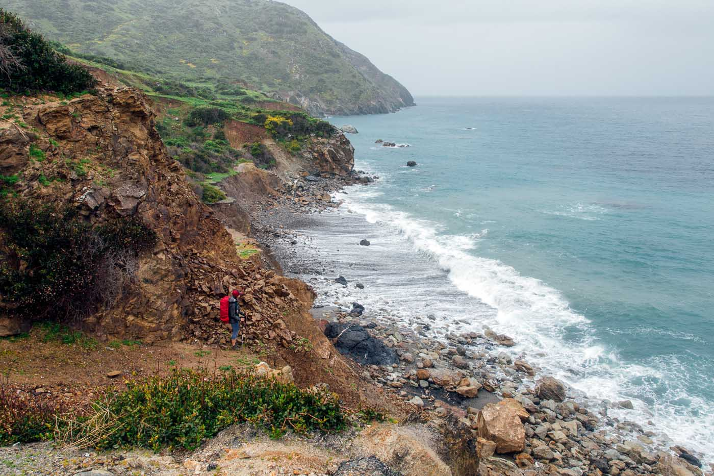 Woman standing at the edge of the rugged coastline of Catalina Island's Starlight Beach