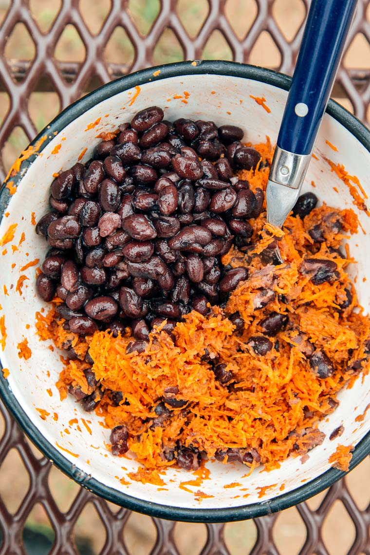 Black beans and shredded sweet potatoes in a bowl.