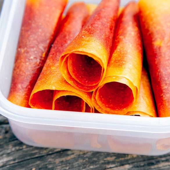 Mango Strawberry fruit leathers stacked in a container