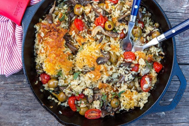 Vegan Paella in a skillet on a wooden table top