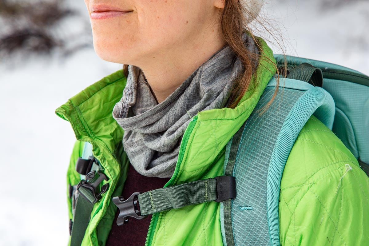 Tight in shot of a woman wearing a neck gaiter