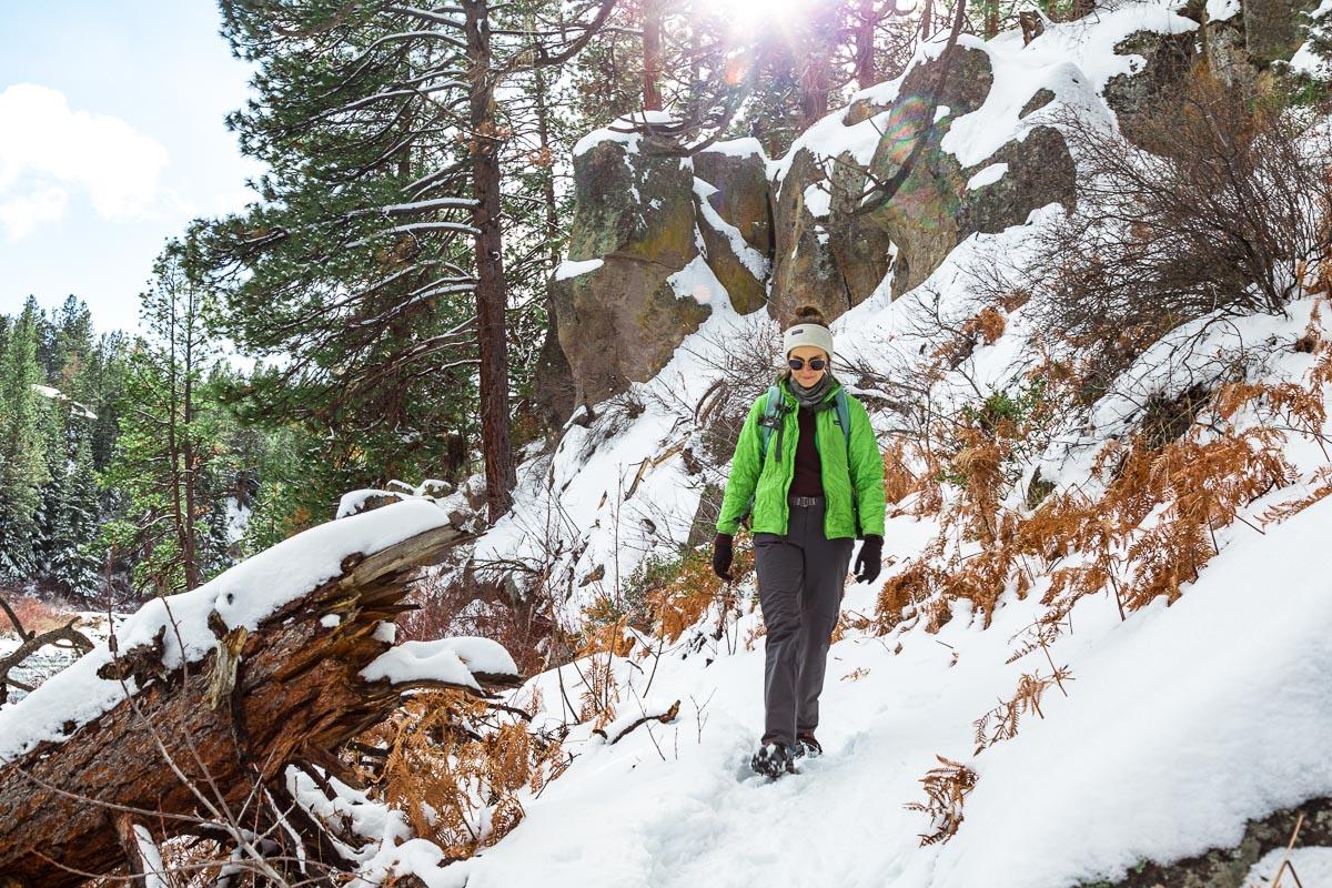 Megan hiking down a snowy trail