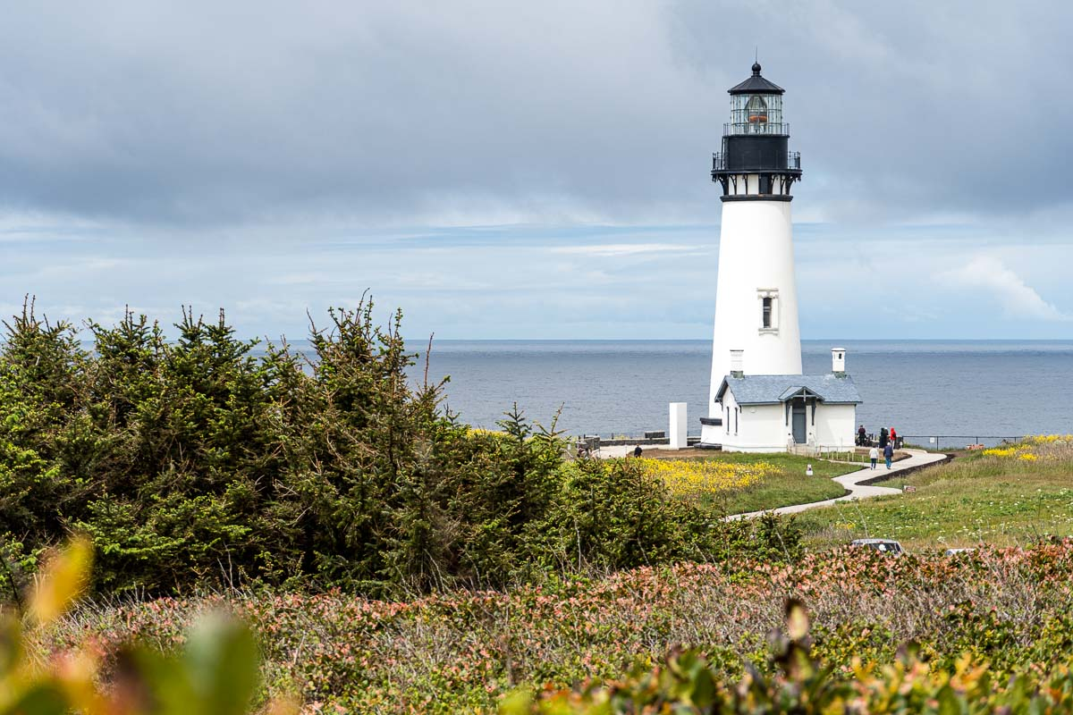The Yaquina Head Lighthouse on a grassy bluff