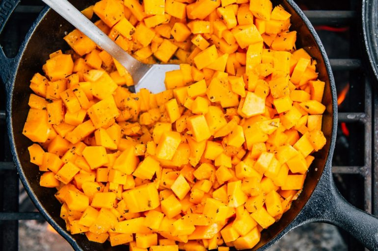 Cubed butternut squash in a cast iron skillet