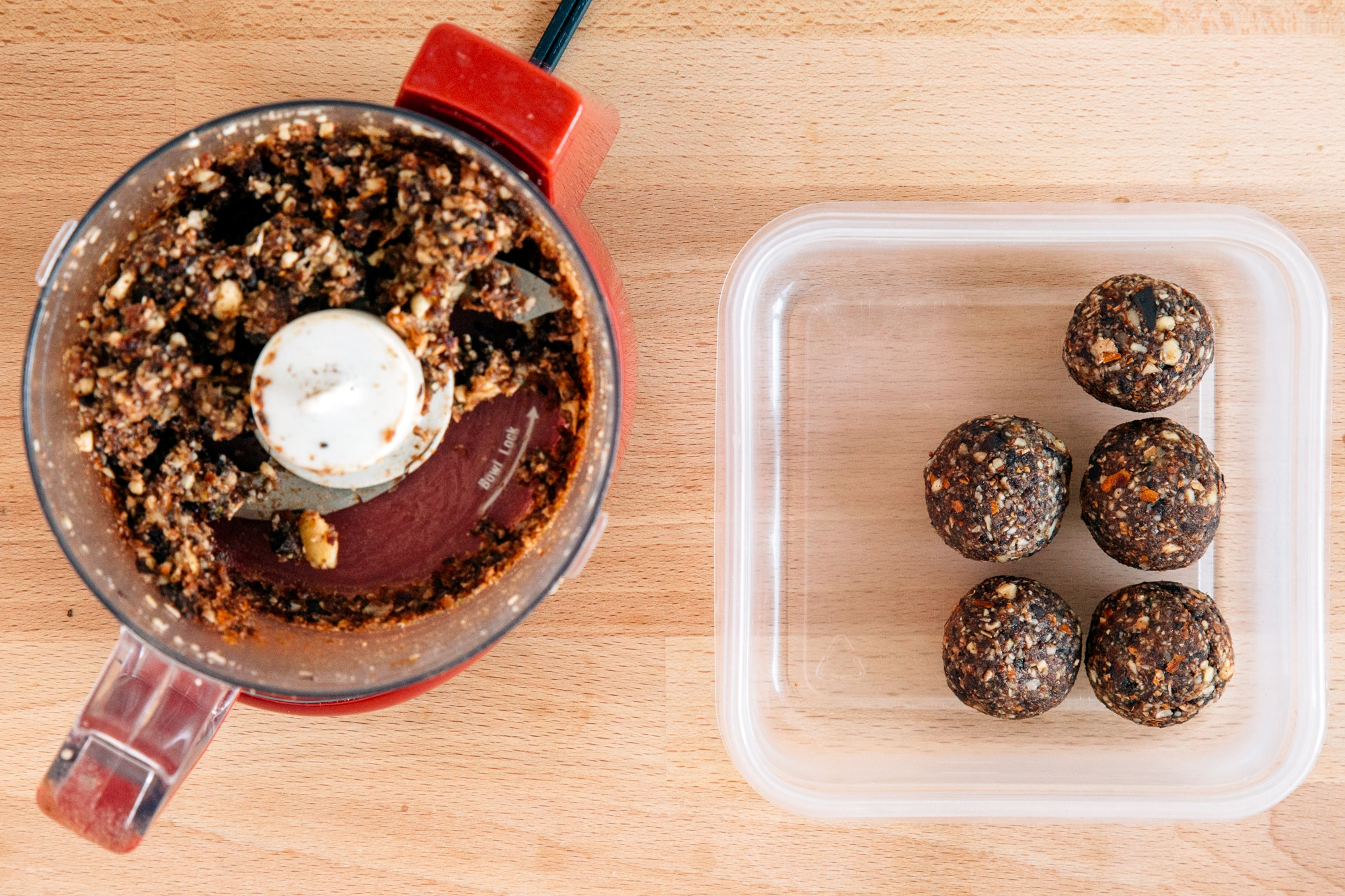 Chocolate cherry energy balls in a tupperware container