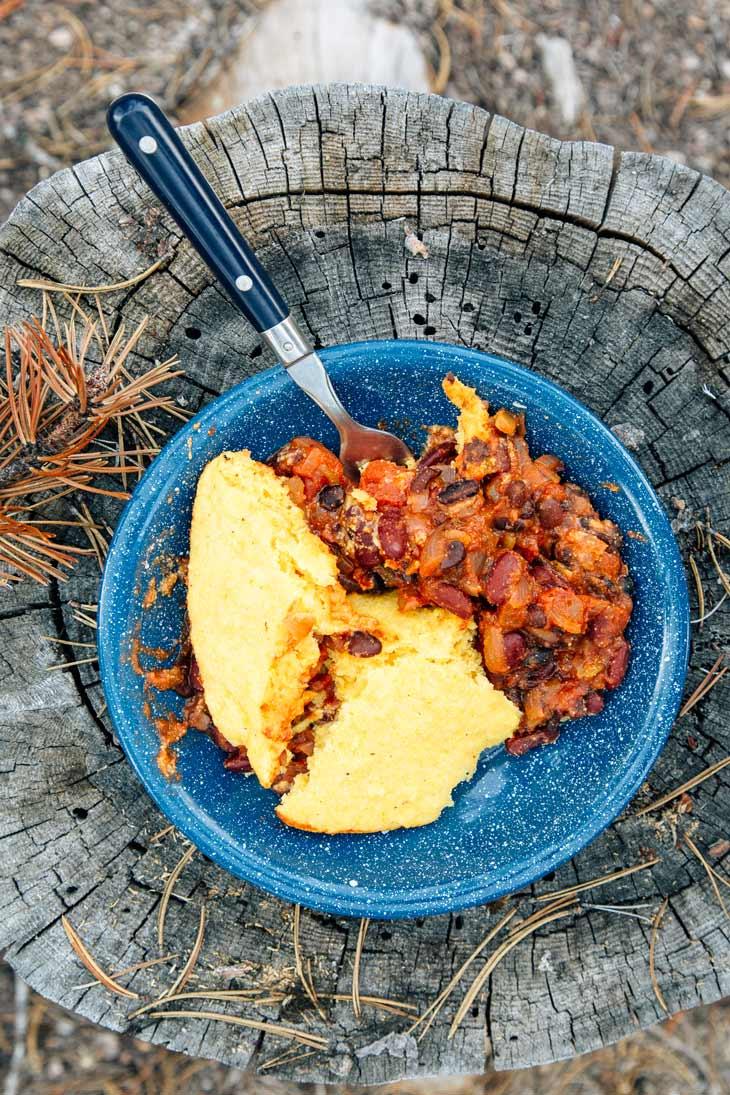 Dutch oven chili and cornbread in a bowl