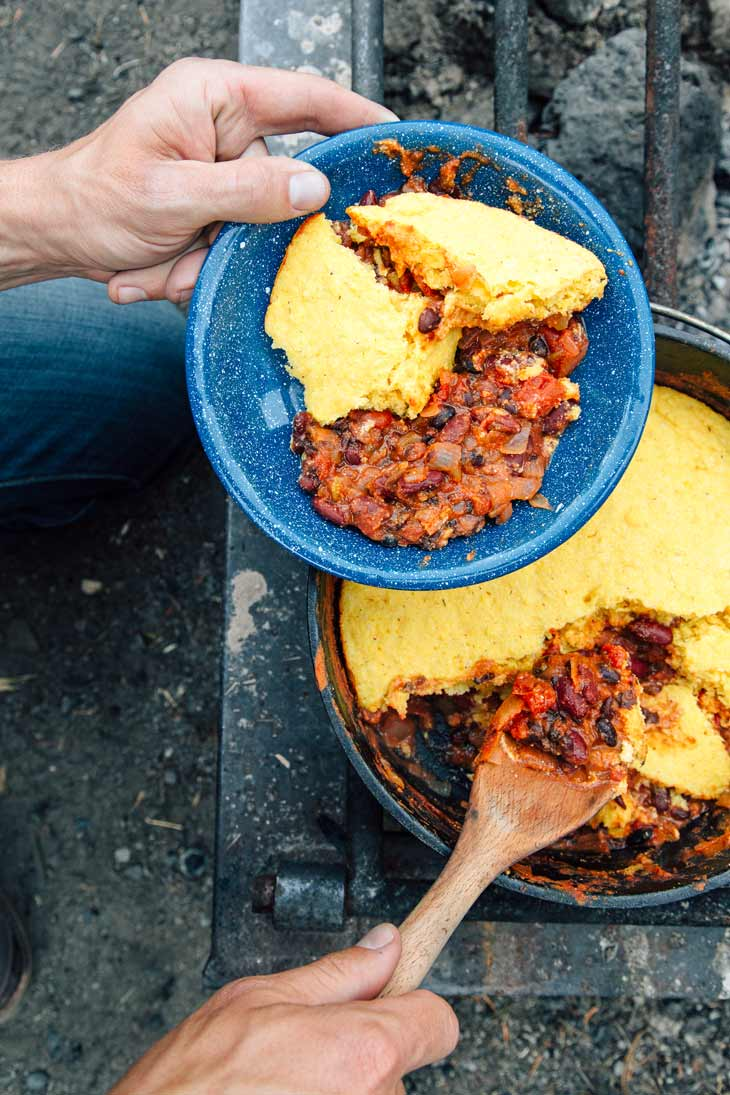 Serving chili and cornbread from a Dutch oven