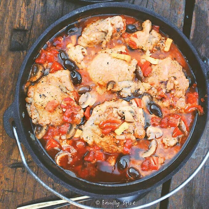 Chicken, olives, and tomato sauce in a dutch oven