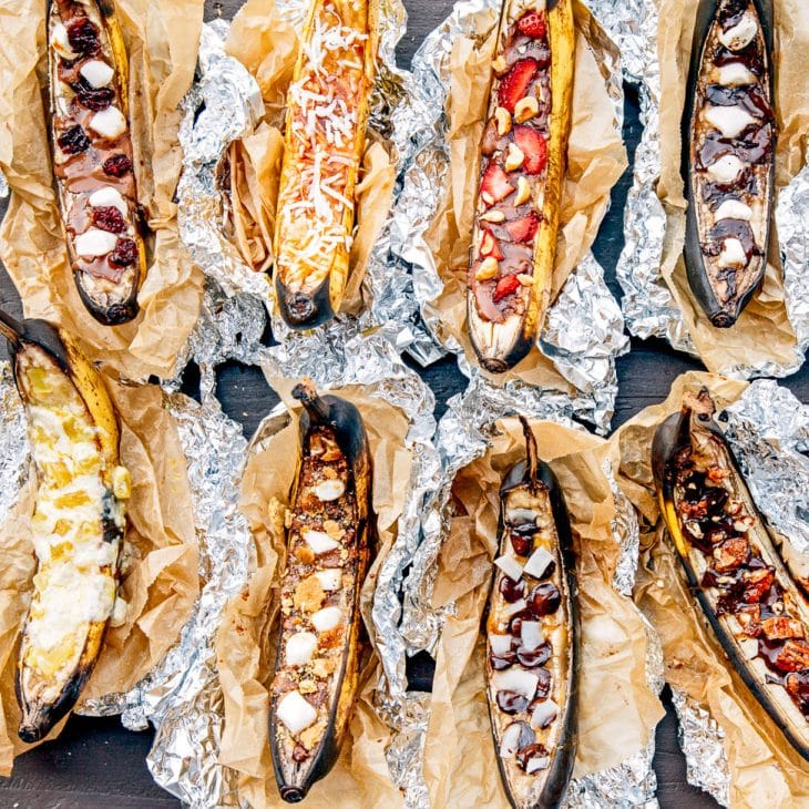 Banana boats in foil with a variety of toppings.