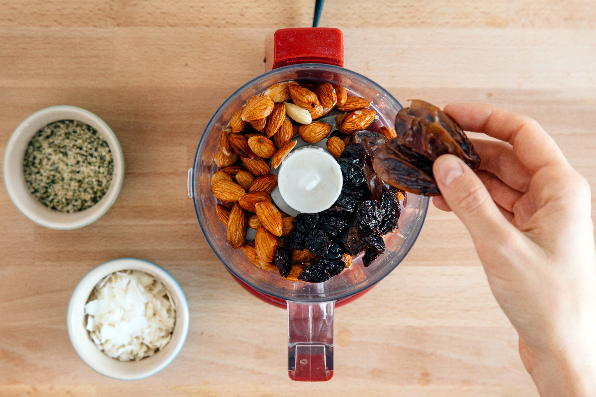 Adding dates into a food processor for energy balls