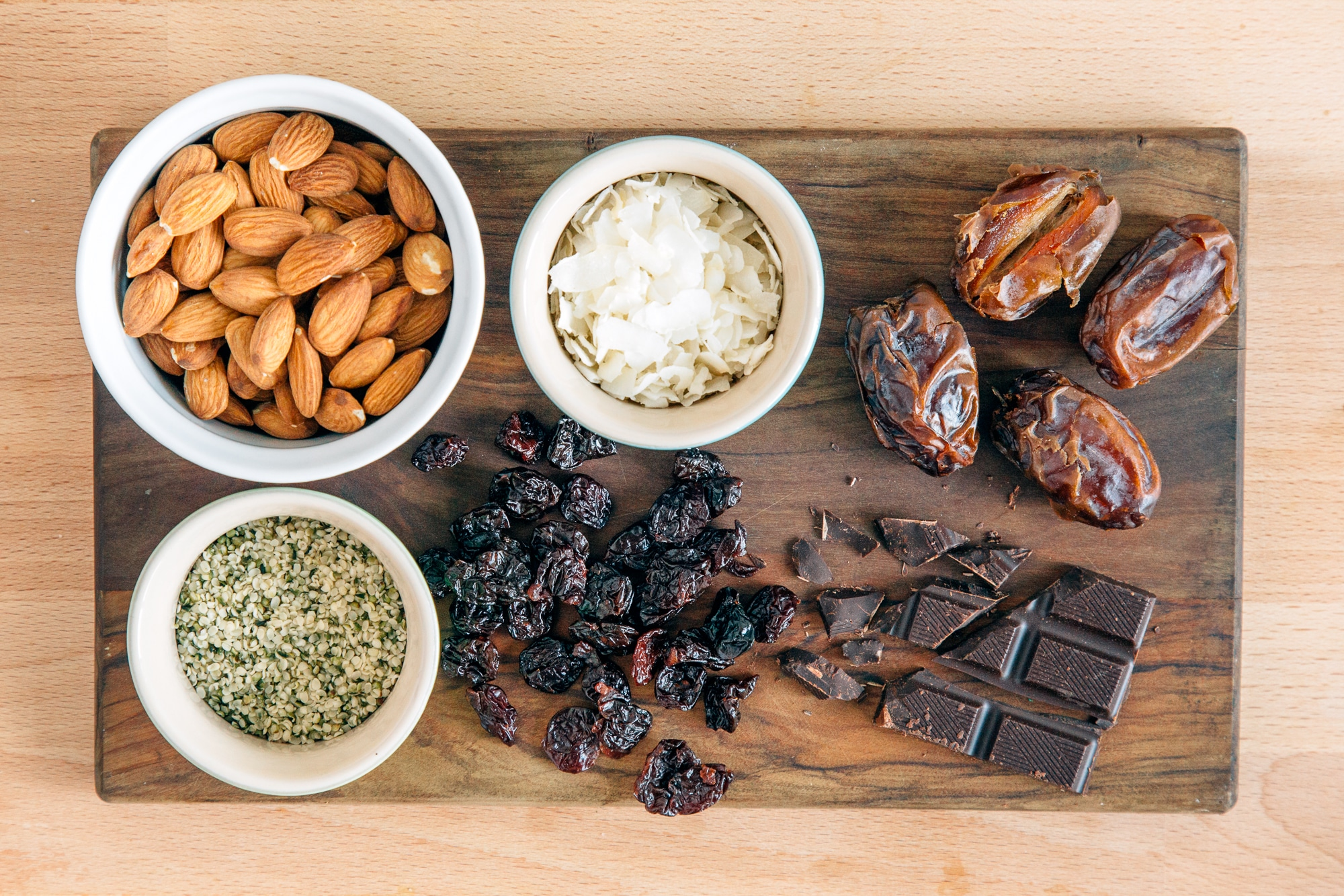 Ingredients for chocolate cherry energy balls on a wooden surface
