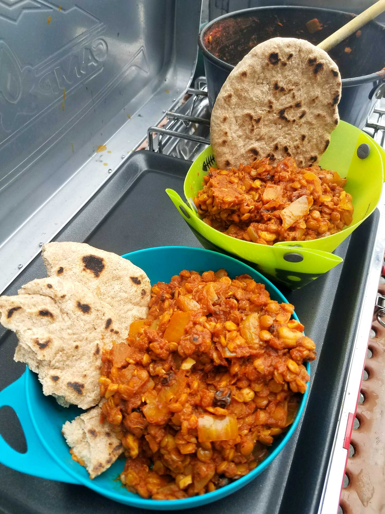 Lentil dhal in a bowl with roti