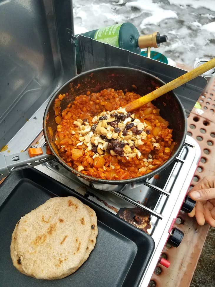 Dhal cooking in a pot on a camping stove