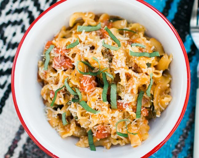 Pasta in a red and white bowl