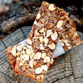 Two granola bars on a stump.