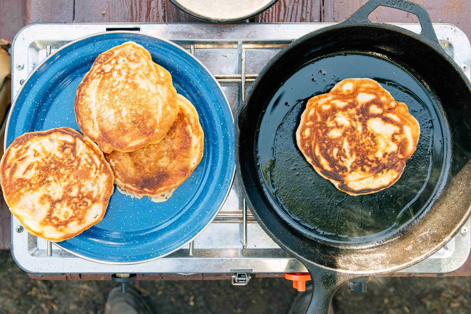 Pumpkin Spice Pancakes cooking on a camping stove