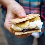 Woman holding a s'more.